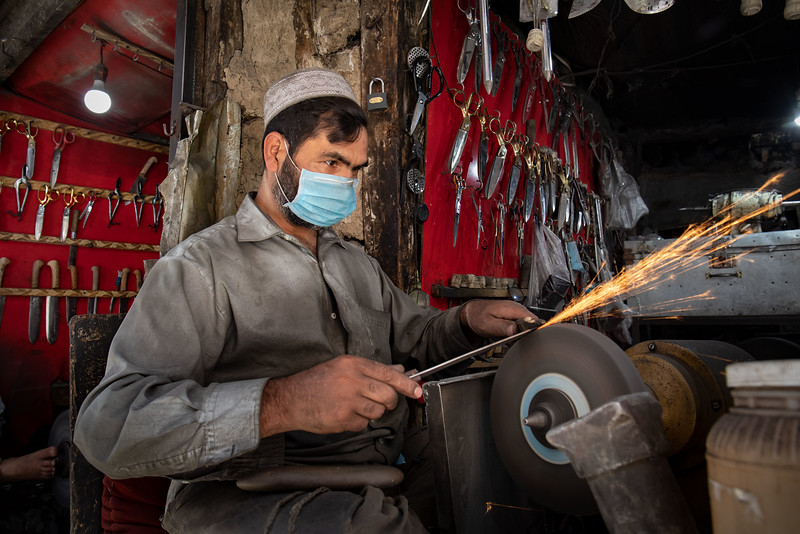 Sharpening knives and other tools, Kabul.
