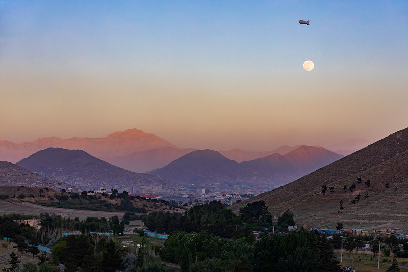 "View from the Qarga Dam showing (almost) full moon and aerostat balloon (""Eye in the Sky""). Kabul."