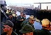 DK86: Don Kaiser (TX) in center facing camera, and other grunts as the USNS Upshur leaves the Oakland, CA dock