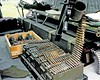 DK-75 A closer view of one of the two M-60s, plenty of ammo for it, plus smoke canisters and hand grenades--including an old 'pineapple' grenade