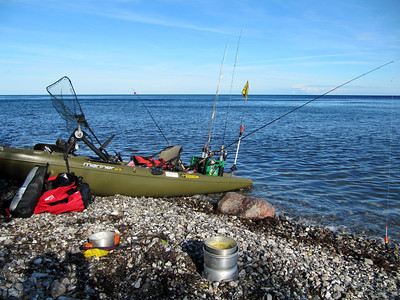 Milk crate holds 3 rods and the gear for fishing. Flag and light for security. Small bag can rest behind the seat for quick access, and bigger drybag under the front hatch.
