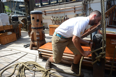 "Tania Barricklo-Daily Freeman Erich VonHasseln, the second mate and the education coordinator on the Kalmar Nyckel sailing ship demonstrates belaying a line which secures a sail line after it has been raised or lowered.The Kalmar Nyckel is a 141-foot reproduction of the 17th century Swedish explorer ship that served as Governor Peter Minuit's flagship for hte 1638 expedition that founded the colony of New Sweden, establishing hte first permanent European settlement in the Delaware.The tall ship will be at he Hudson River Maritime Museum inKingston, N.Y. through Sunday, August 12 and will be providing deck tours, public sails, and special ""pirate sails"". Deck tour sails are Saturday, 10am-6pm, Sunday 2pm-6pm. Adults $10, Ages 17 and under $5, free for age 5 and under."