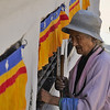 Woman turning prayer wheels.