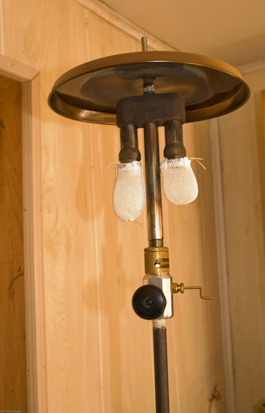 Gas lamp, lit by holding flame to white part.
