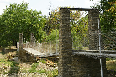 Swinging bridge over Wildcat creek in Moline, KS, built in 1904. Claimed to be the oldest swinging bridge in Kansas. For more information about Moline, see: http://www.skyways.org/towns/Moline/index.html