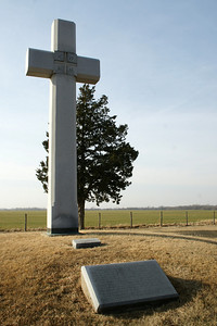 Cross and monument to Juan Padilla west of Lyons, Kansas. There are also monuments to him in Herington and Council Grove Kansas. He was a Franciscan friar who went with Coronado to Kansas in 1541 in the search for Quivira. Father Padilla returned later and was killed by Indians.  For more infomation about this monument see:  http://skyways.lib.ks.us/history/padilla.html