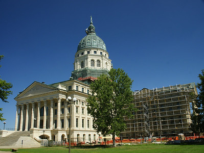 Kansas State Capitol building in Topeka, currently undergoing renovation. Construction took 37 years ending in 1903. Total cost was more than 3,000,000 dollars. For more information, see the Kansas State Historical Society page:  http://www.kshs.org/portal_capitol