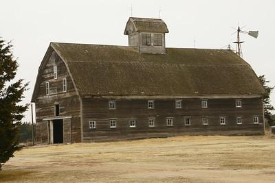 John Rice horse barn near Cullison, KS in Pratt County, built 1909. Large gambrel roof barn visible from several miles away.  For more information see: http://www.kshs.org/resource/national_register/nominationsNRDB/Pratt_RiceJRFarmsteadNR.pdf