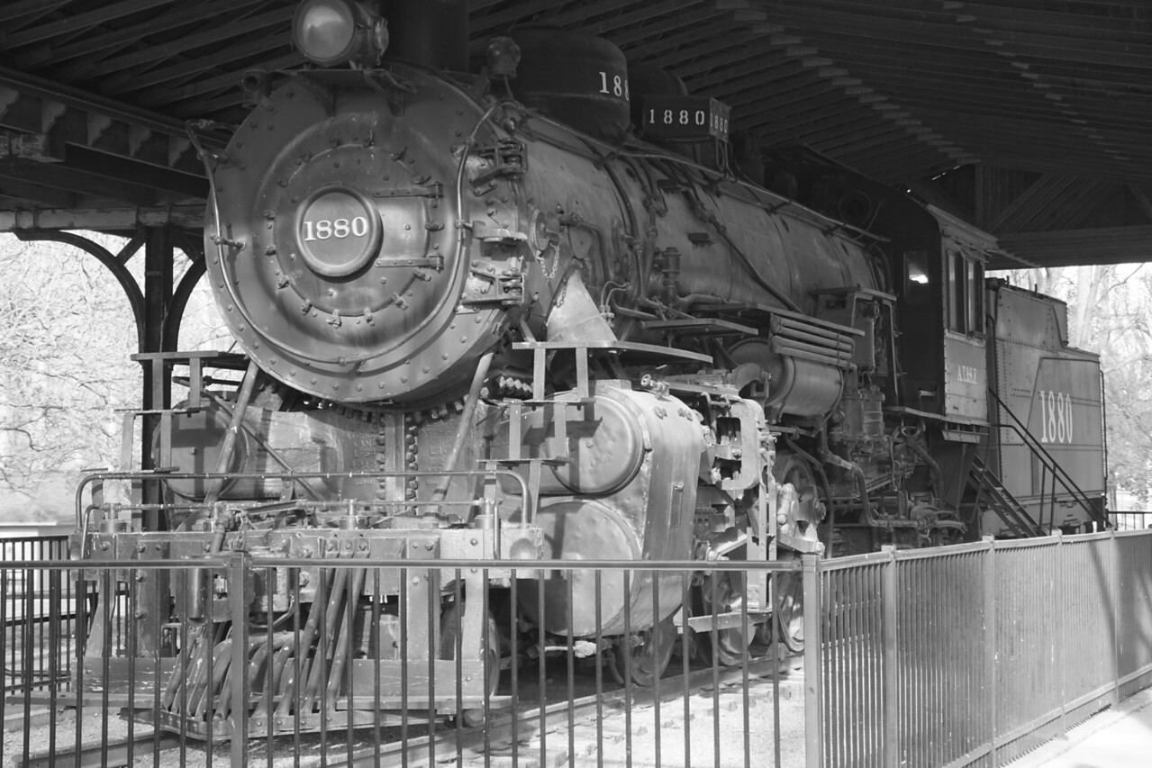 Historic Santa Fe steam locomotive in Military Park in Newton. Saved in black and white.