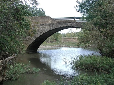 Damaged stone arch bridge over Homer Creek - Greenwood County, Kansas