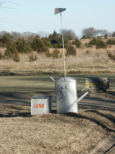 Mailbox mounted on old hand crank water pump - Harvey County
