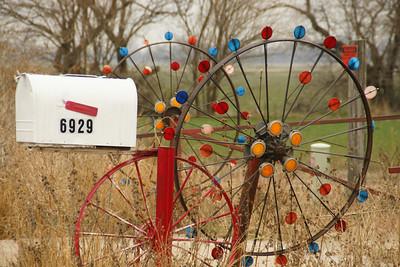 Wagon wheel reflectors mailbox - Harvey County