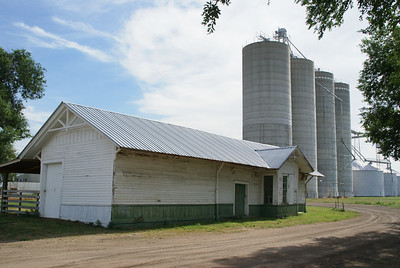 Railroad depot building and grain bins in Sylvan Grove