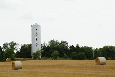 Beverly water tower seen across wheat field