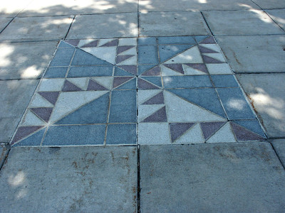 Quilt pattern in sidewalk in Great Bend at courthouse square. Barton County, Kansas