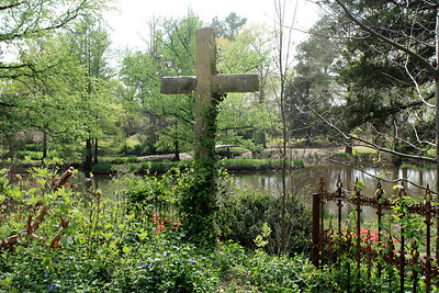 Garden, cross, fence and pond. Photo by Karen.