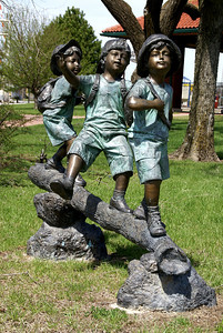 """Children at Play"" sculpture on lawn near Missouri Pacific Depot"