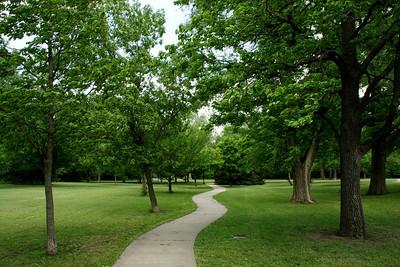 Walkway through the trees in Lemon Park in Pratt