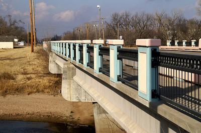 Pink and blue bridge over Little Arkansas River along Meridian Ave