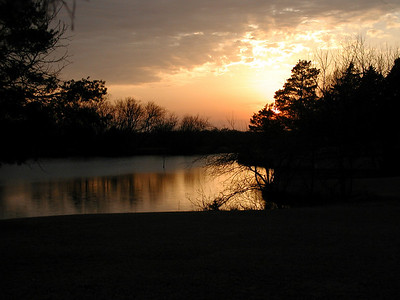 Sunset over lake at Alorie Lodge on north Woodlawn Ave