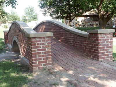 City park in Macksville - elegant brick footbridge