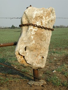 Rock chained to fence post north of Elgin
