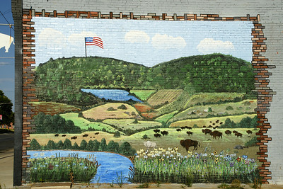 Mural on downtown building depicting South and West Mounds and Fall River valley