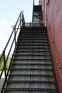 Elegant iron fire escape stairs on downtown building