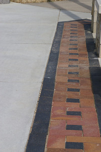 Brick inlay in concrete sidewalk around courthouse in Jetmore