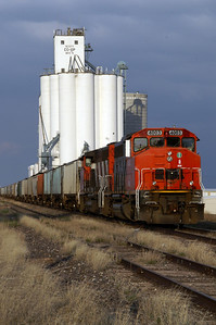 Train parked by grain elevator in Scott City