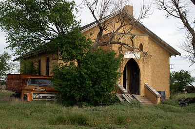 Abandoned stucco Methodist Church in Manning
