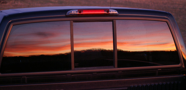 Sunset reflected in my truck window