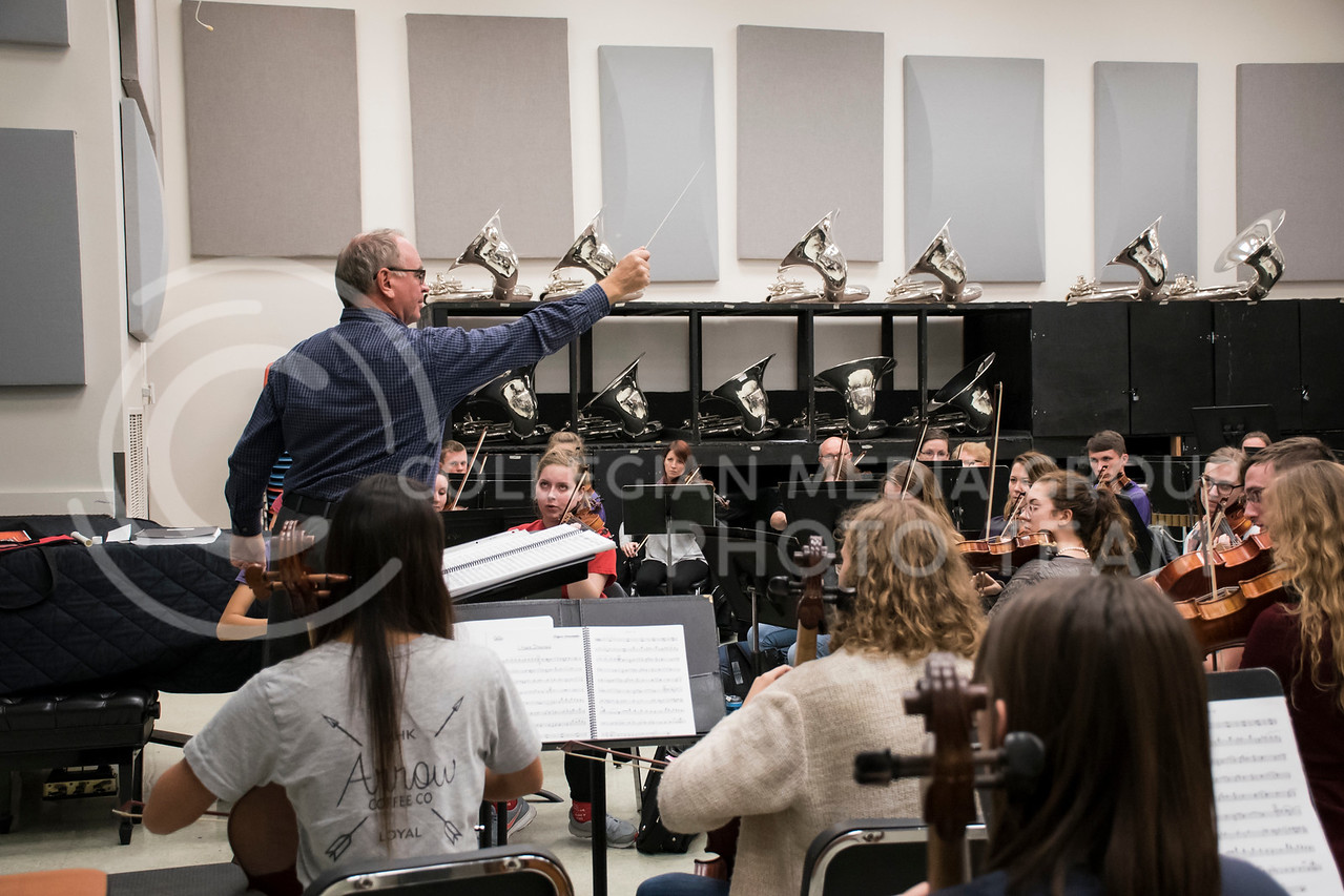 Dr. Lettrell leads the members of the Kansas State Orchestra during rehearsal in the McCain Building, in Manhattan, KS, on Nov. 6, 2017. (Olivia Bergmier | Collegian Media Group)