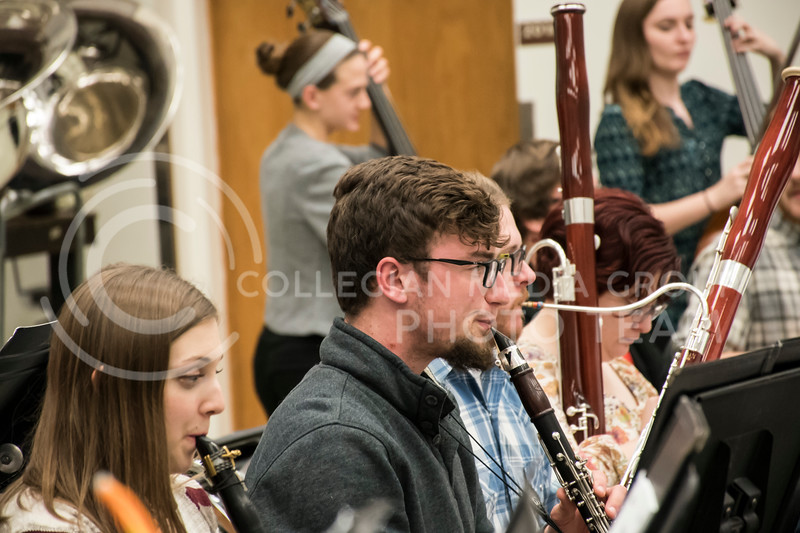 A woodwind player looks up to make sure they are in sync with Dr. Littrell during Rehearsal for the Kansas State Orchestra in the McCain Building in Manhattan, KS, on Nov. 6, 2017. (Olivia Bergmeier | Collegian Media Group)