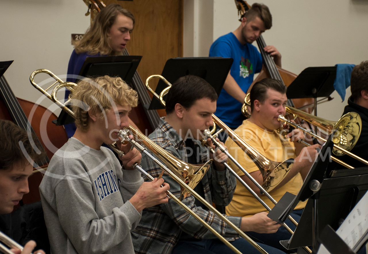 The trombone section in the Kansas State Orchestra plays during rehearsal in the McCain Building in Manhattan, KS, on Nov. 6, 2017. (Olivia Bergmeier | Collegian Media Group)