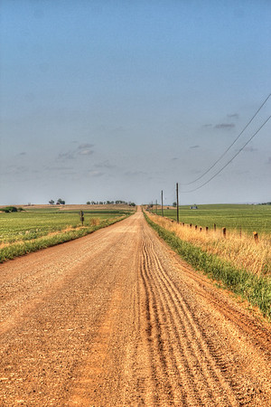 Lines in the gravel stretch for miles on this road in Kansas.