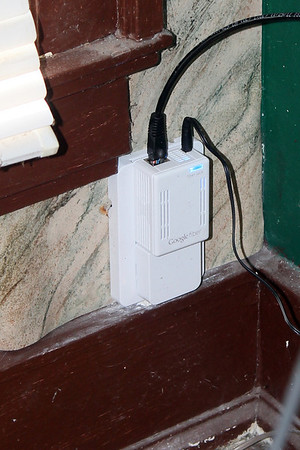 The box that converts the light to Cat5 and back.<br /> The black cable going up, goes to the modem.
