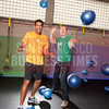 Fitmob- Raj Kapoor, Chief Motivator and CEO (orange shirt) and Paul Twohey CTO and co-founder (green shirt) at FitMob offices/gym in SF