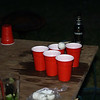 Some beer pong was played; here's a ball just tipping over the lip of the cup.