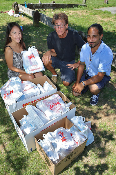 Kira Andreucci, 15 on left, who runs Karing $ Kids that helps feed her fellow students during the school year on the weekends has started to help the kids during the summer. She delivers packages that contain Cereal, milk, macaroni & cheese, Cookies and snacks for the kids in the Fitchburg Park and Recreation Department. They started the first week of July this year. With Andreucci is her dad John Andreucci and Fitchburg Parks and Recreation Department Supervisor Sam Elmasri, on right. They deliver to 50 plus kids each week this summer. SENTINEL & ENTERPRISE/JOHN LOVE