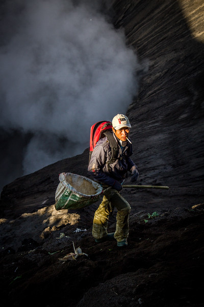 Some people known as 'catchers' risk their lives by climbing onto the steep inner slope of the crater. Armed with nets they run and jump to try and catch the offerings before they reach the choking heart of the volcano - the belief is that each item they catch is a blessing from the god.