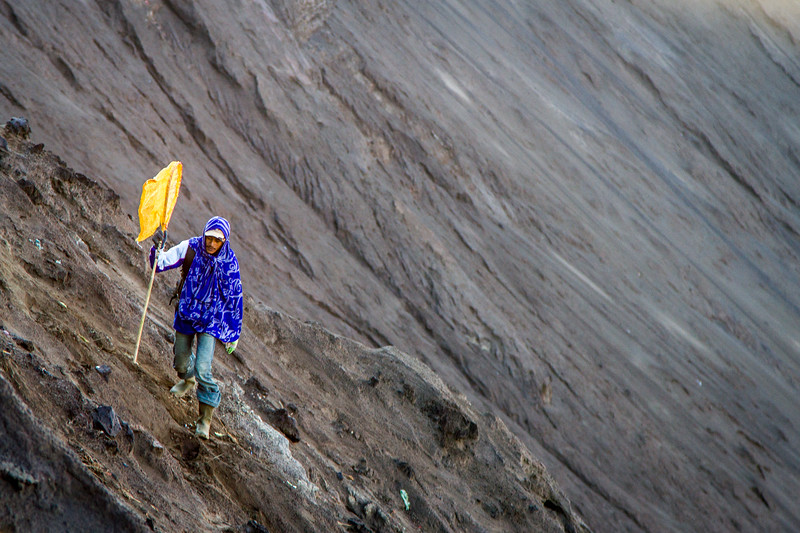 A catcher with his net on the steep inner slope of Mt Bromo.