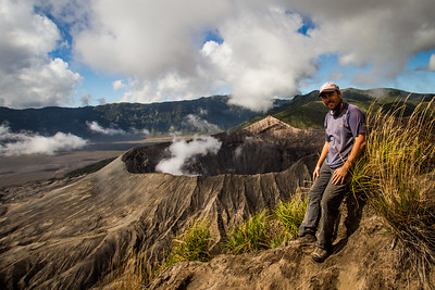 The photographer, Paul Williams on the summit of Mt Batok which overlooks the active volcano of Mount Bromo.