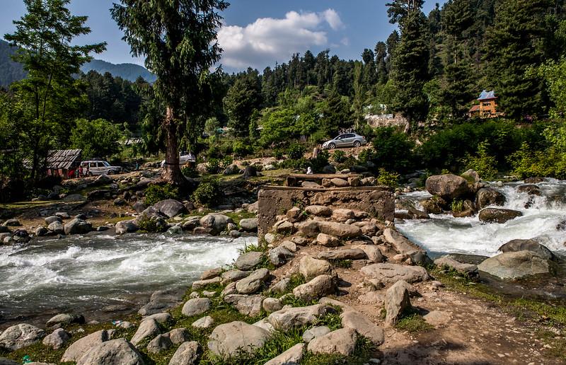 Wooden bridge leading to Daksum, Kashmir, India