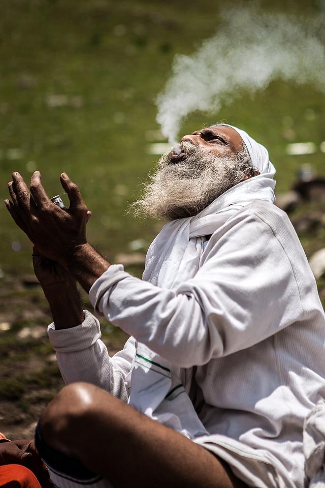 Sadhu lost in smoke, Kashmir, India