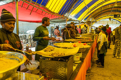 A lavish variety of food is provided by a bhandara from Delhi at Poshpathri, just after the highest point of the Amarnath yatra.
