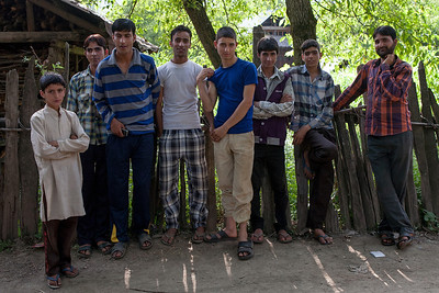 The youth of Kashmir, teenage boys take a break from a game of cricket and pose for a photograph in Kashmir.