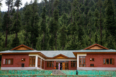 A guest house, run by the Jammu and Kashmir Tourism department, surrounded by pine trees, at Chandigham in Lolab valley, Kupwara district in northern Kashmir, India