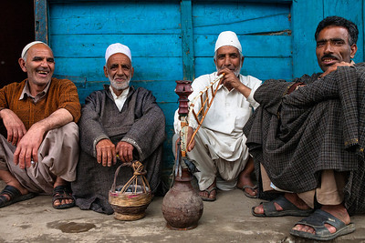 Old men, attired traditionally, in firan (loose woolen coat), with kangdi (basket with red hot charcoal pieces) keeping them warm, sharing a hookah/sheesha is as idyllic as it gets in the small town of Verinag in Kashmir.