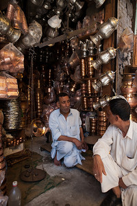 A shopkeeper in his shop in the Anantnag market in Kashmir where he sells utensils mainly highly decorative ones made of copper like the Samovar used to serve tea.